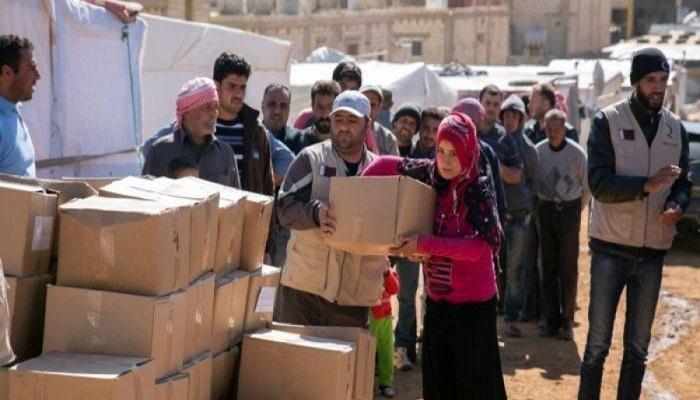 نتيجة بحث الصور عن توزيع مساعدات على النازحين