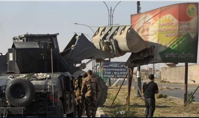 ازالة اللافتات التي تدعو لتقسيم العراق والتي قام حزب بارزاني بنشرها في المحافظة